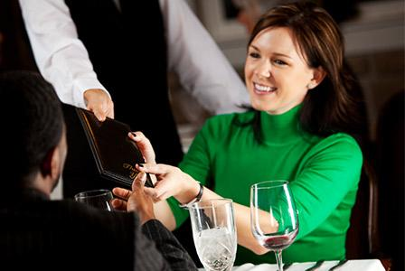 woman-paying-bill-at-restaurant_kixekv.jpg
