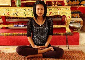 Women doing Lotus pose