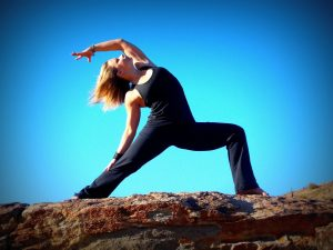 Woman doing Warrior pose