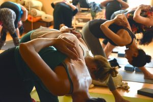 Girls at fitness studio doing exercises.