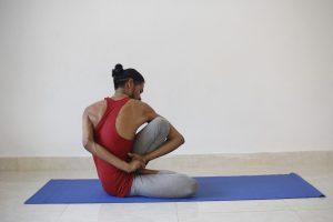 Man doing advanced Yoga pose.