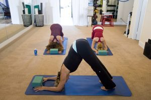Girls doing Yoga at fitness class